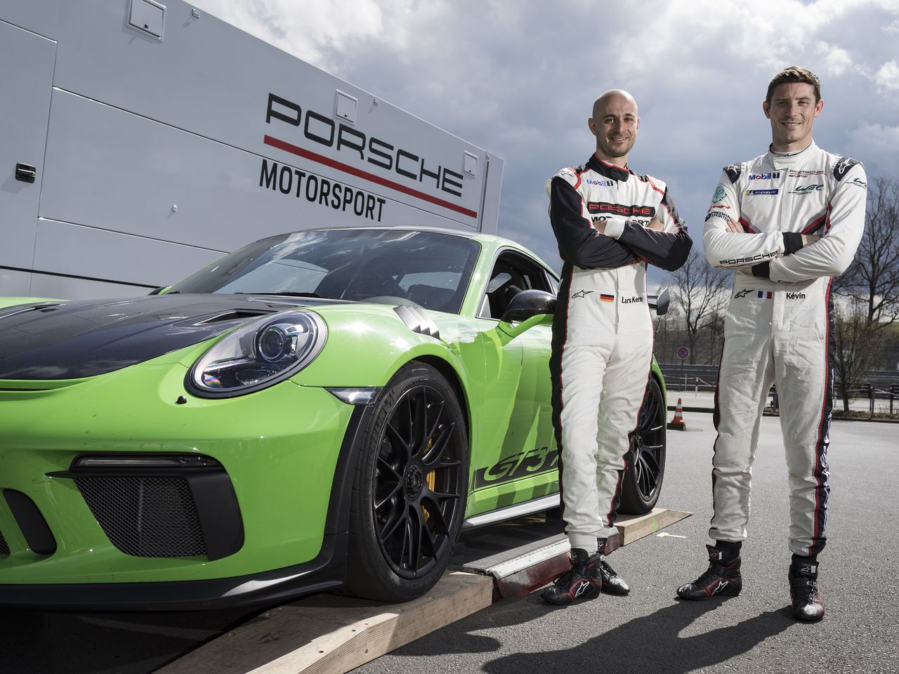 Lars Kern and Kévin Estre (left) were the record-setting drivers. A Porsche factory driver, Estre was at the wheel when ...