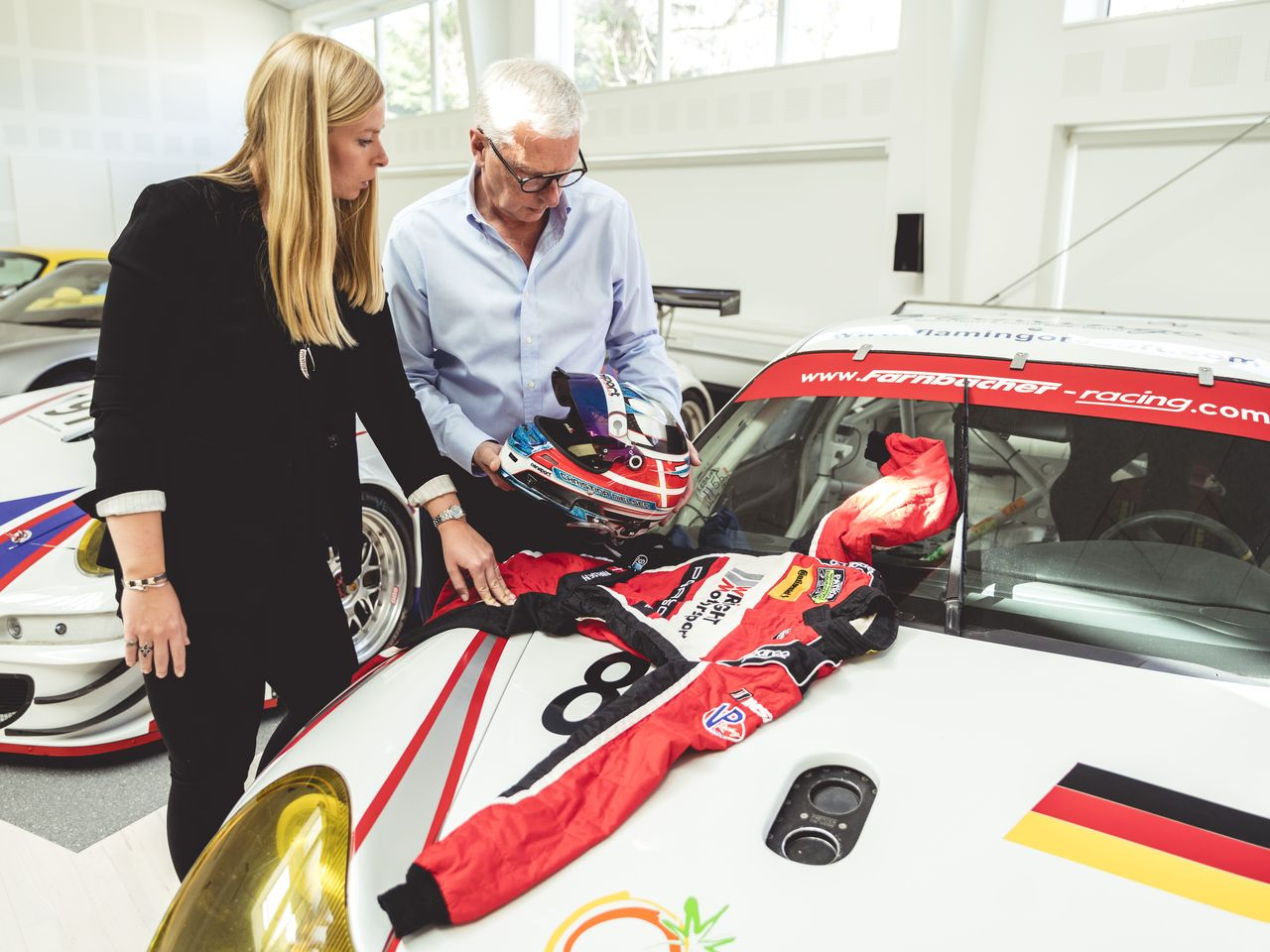 Nielsen takes her new racing suit home, laying it out on the hood of a Porsche 996 GT3 RSR for her father Lars Erik to inspect. In 2006 he drove this car to a second-place finish in the GT2 class in Le Mans.