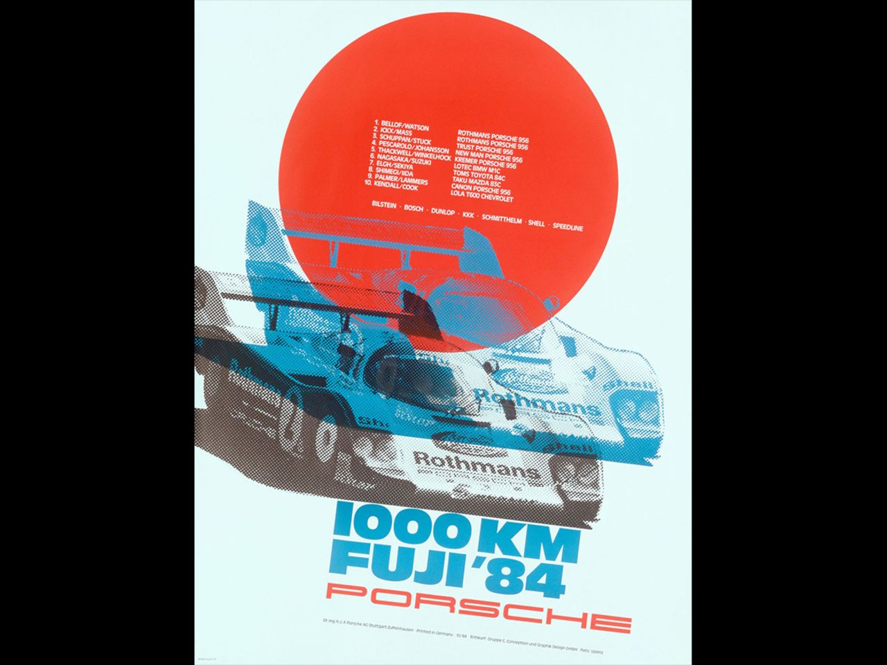 This poster commemorating the legendary victory by the Porsche 956 at the 1,000 Kilometers of Fuji in 1984 features a background reminiscent of the Japanese flag.
