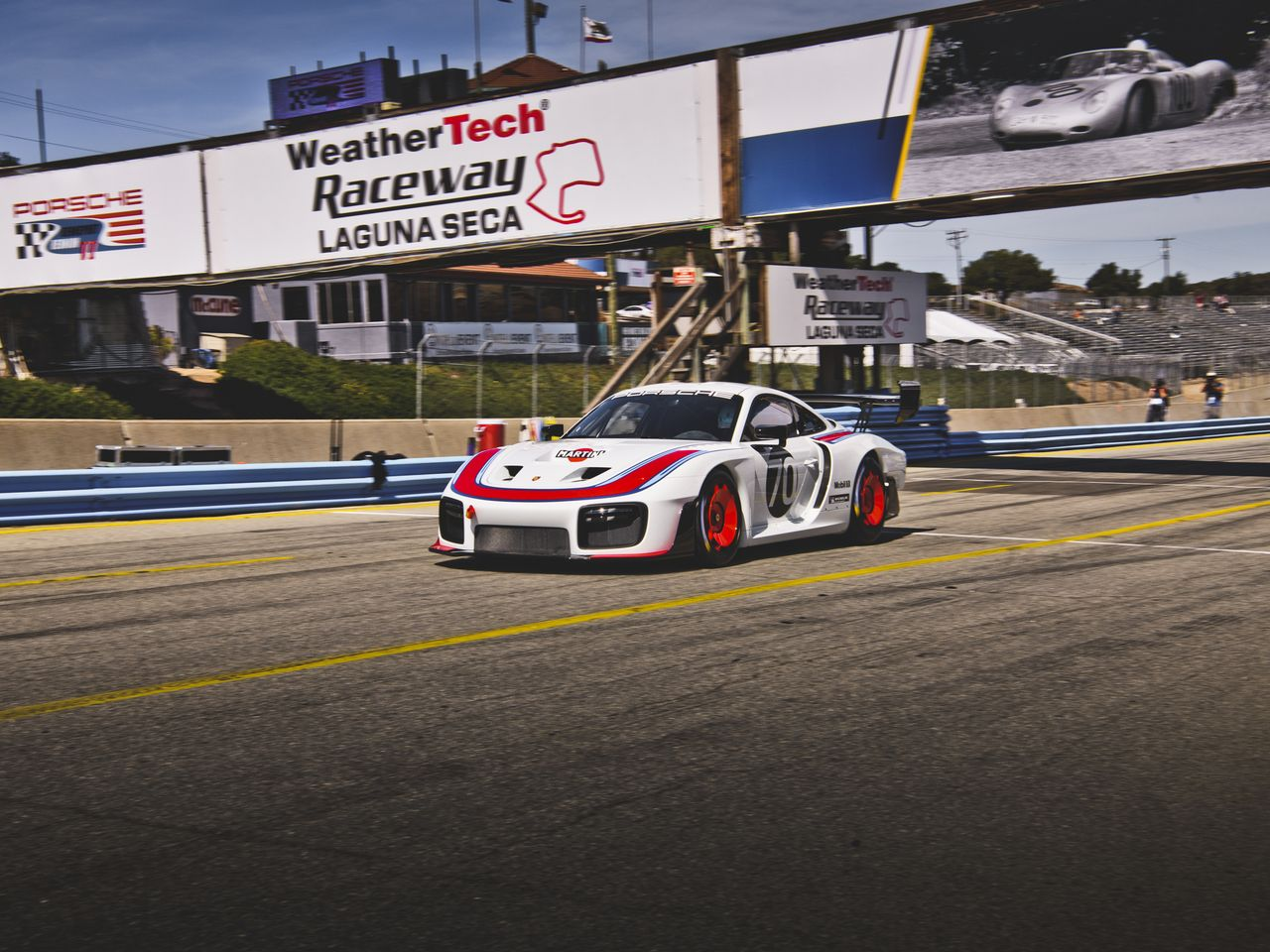 The new Porsche 935 takes the renowned Corkscrew at Laguna Seca Raceway in Monterey, California, with aplomb. With just seventy-seven units built, Porsche aims to ignite the racing world with the new car.