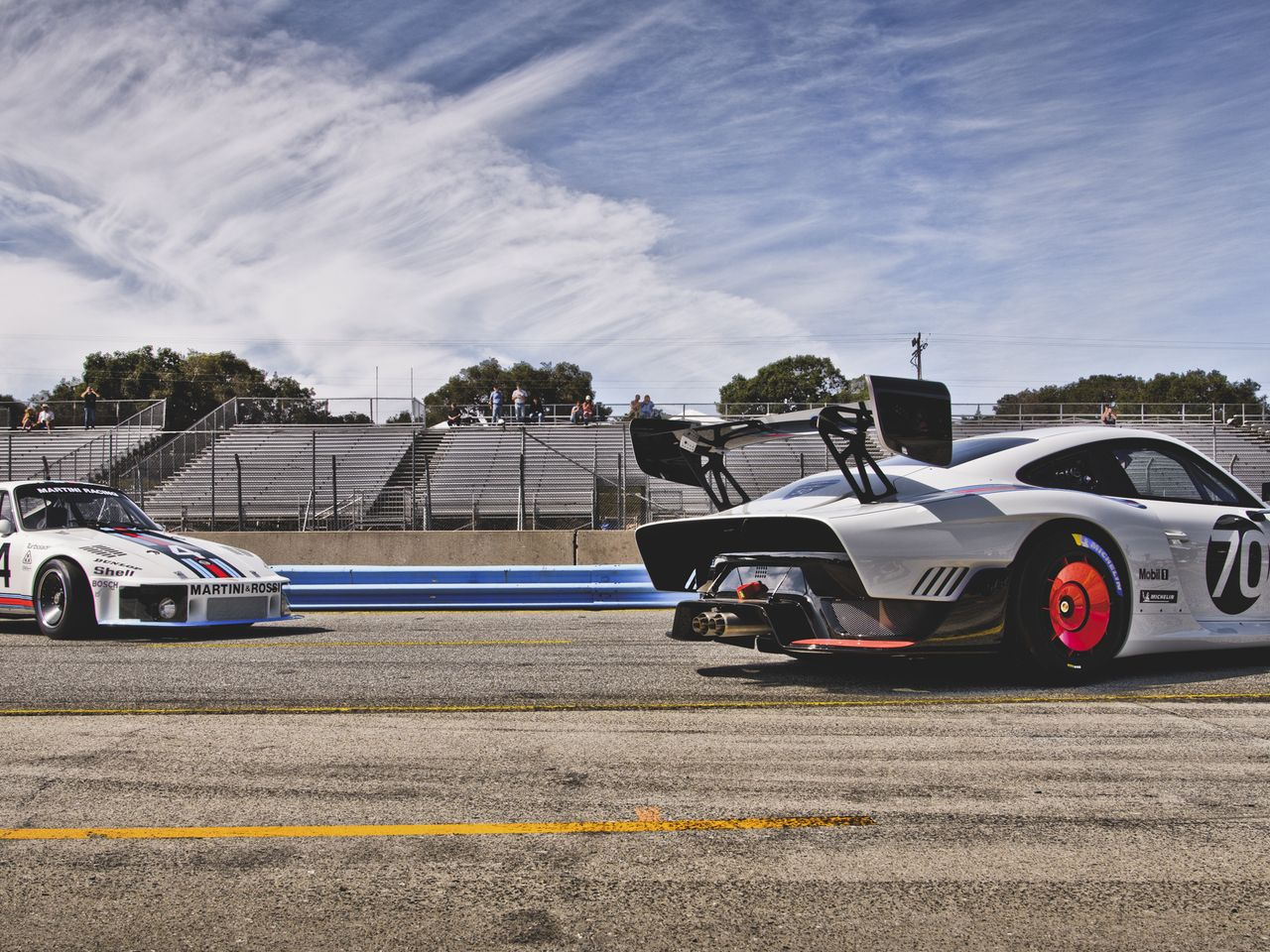 "The new Porsche 935 (right) and its iconic role model, the ""Moby Dick"" Porsche 935/78."