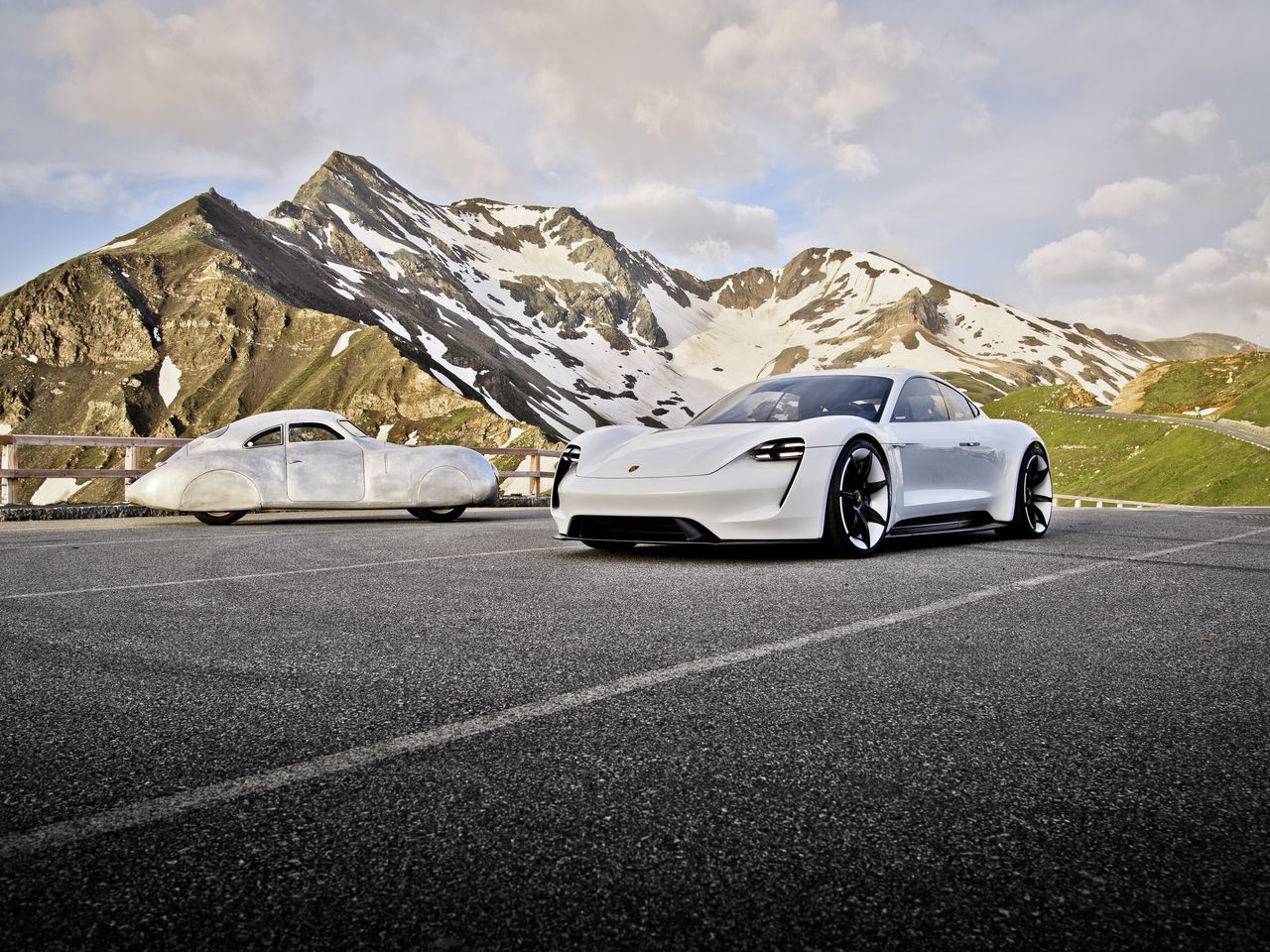 "Bogner brought together the entire history of Porsche on Austria's highest mountain: From the Porsche Type 64 designed by Ferdinand Porsche in 1939 (often referred to as the ""Berlin-Rome car"") to the Mission E concept car."