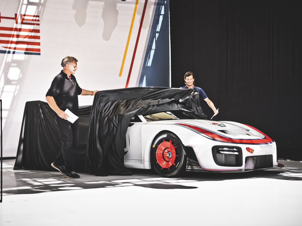 Detlev von Platen (left), Porsche Board Member for Sales, joins Mark Webber to present the latest edition of the legendary race car of the 1970s, the Porsche 935.