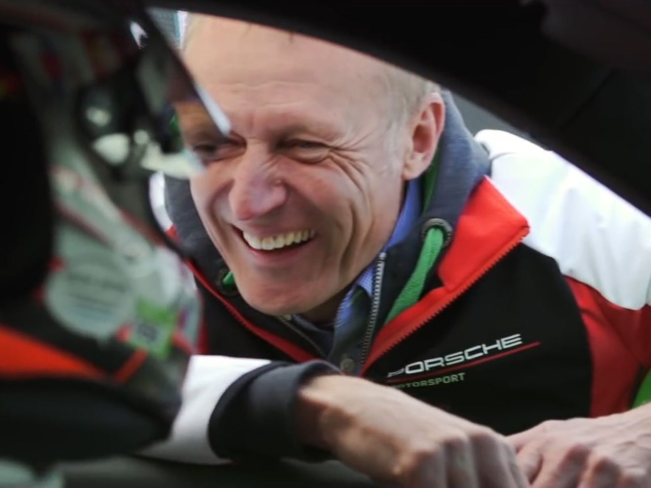 Andreas Preuninger, director of the GT model line, is visibly delighted as he congratulates Estre on the high-speed lap.